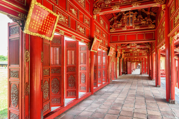 Red wooden hallway in the Purple Forbidden City, Hue, Vietnam Red wooden hallway in the Purple Forbidden City of the Imperial City within the Citadel in Hue, Vietnam. Hue is a popular tourist destination of Asia. huế stock pictures, royalty-free photos & images