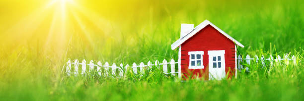 red wooden house on the grass stock photo
