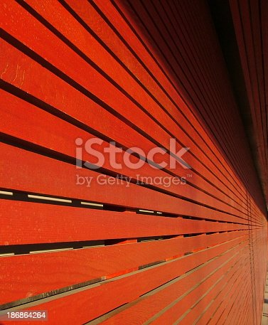 486568999istockphoto Red Wooden Slats With Perspective 186864264