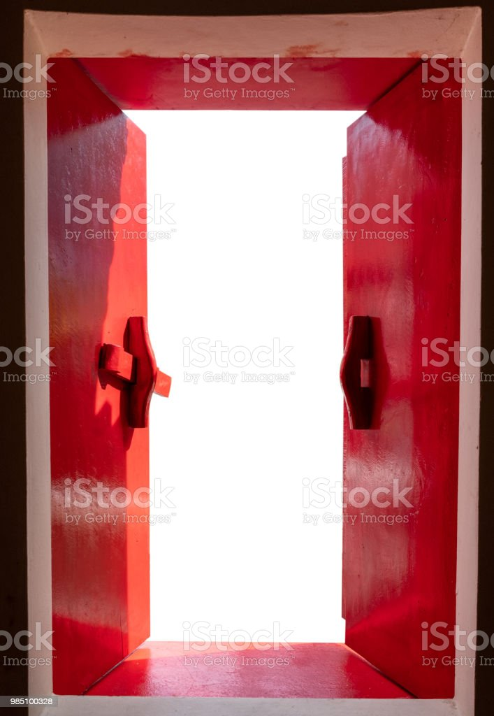 Red wooden windows opened with sunshine on white background stock photo
