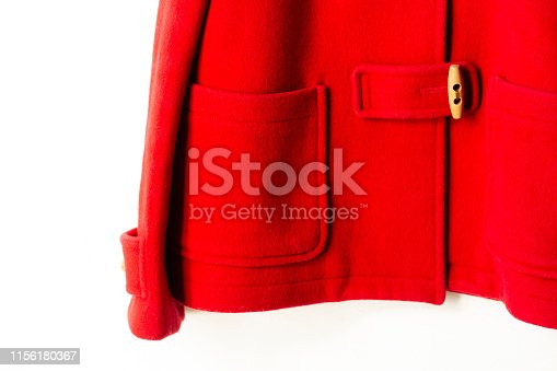 red wool coat hanging on clothes hanger on white background.Close up