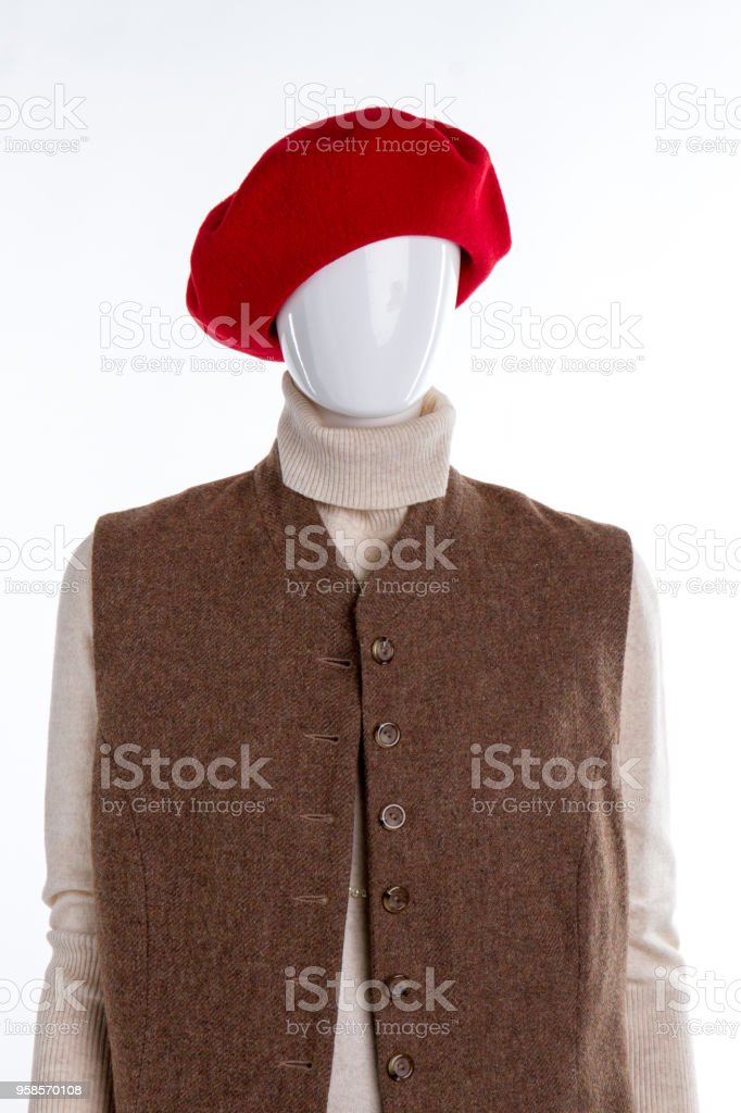 Red woolen beret on female mannequin. stock photo