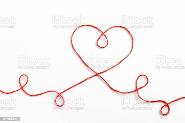 Red woolen thread in the shape of heart on white background picture id897630942?b=1&k=6&m=897630942&s=612x612&h=lc3d86c c8x760foafaxnfkh klodhg6enkrdbu2hnw=