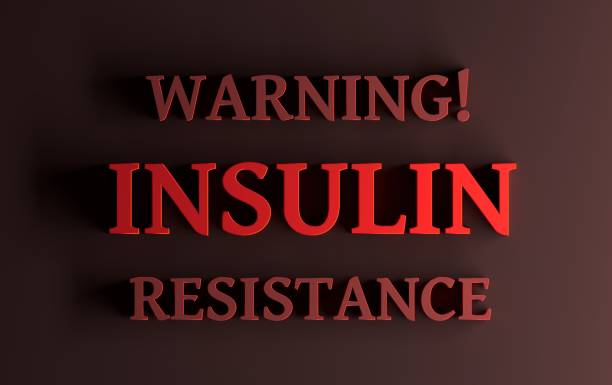 Red words - Warning Insulin resistance on dark red background stock photo