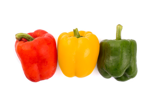 Red , yellow and green bell pepper isolated on white background