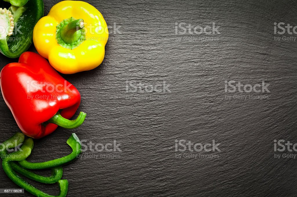 Red, yellow and green bell peppers stock photo