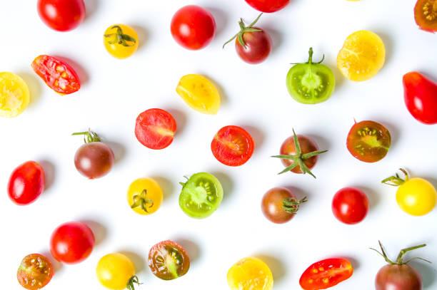 röd gul och grön körsbärstomater bakgrund - körsbärstomat bildbanksfoton och bilder