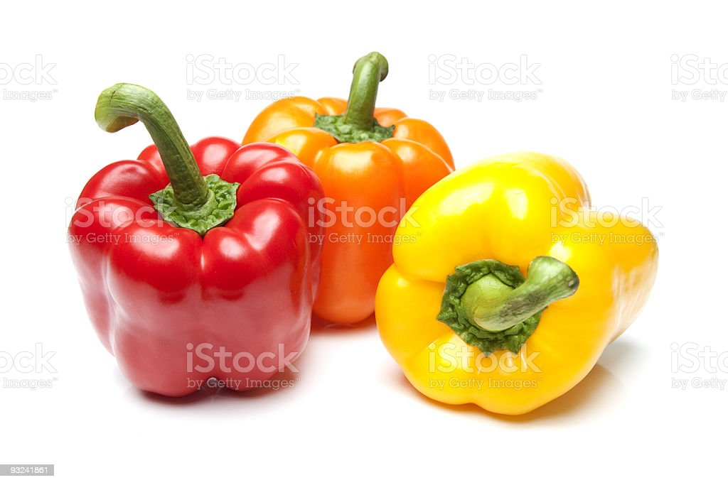 Red Yellow and Orange Bell Peppers on Isolated White royalty-free stock photo