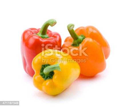 Three bell peppers isolated on white.