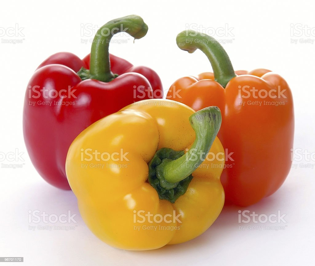 Red, yellow, and orange peppers isolated on white stock photo