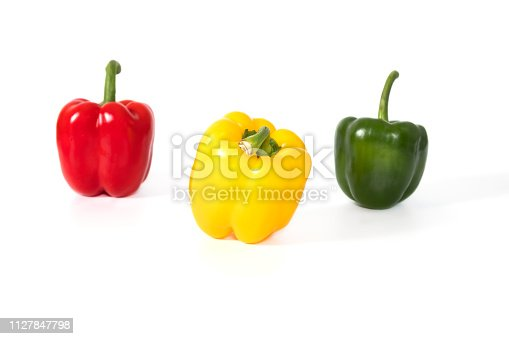 Red, yellow, green fresh and healthy peppers on white background