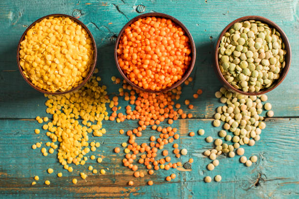 Red yellow green lentils high angle view stock photo