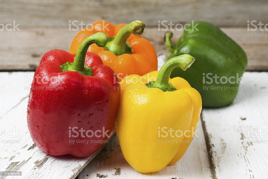 Red, Yellow, Orange and Green Bell Peppers stock photo