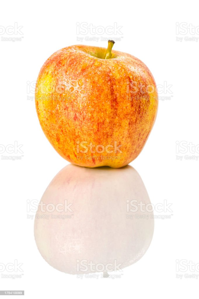 Red yellow wet apple isolated on white backgound with reflection stock photo