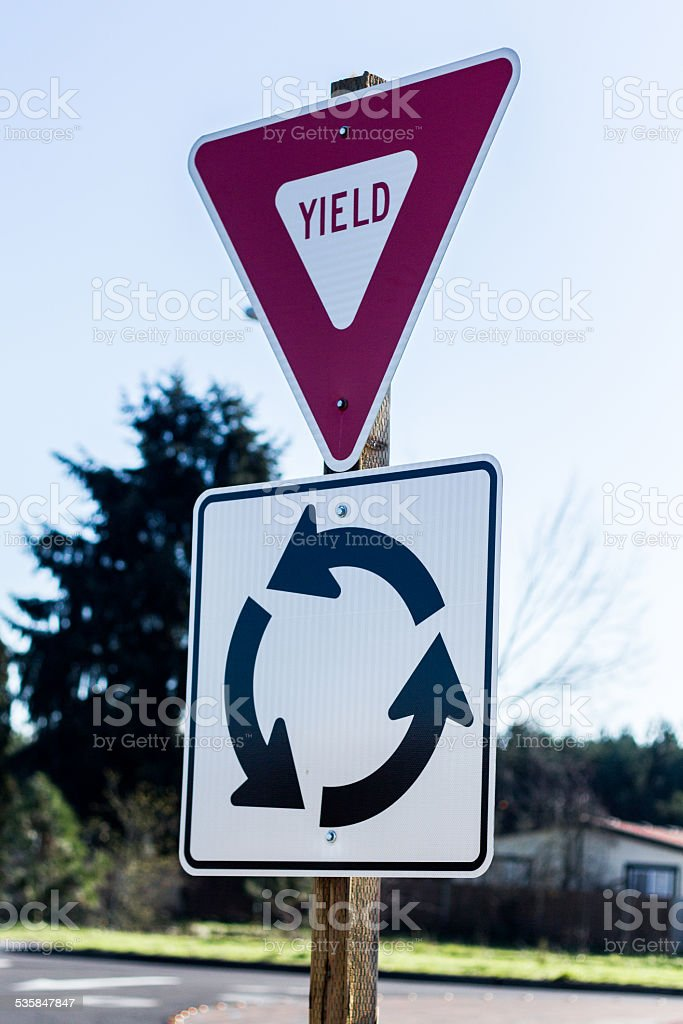 Red Yield & Whtie Roundabout Sign stock photo