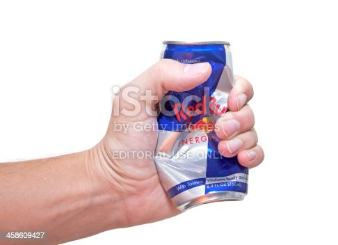 Nashville, Tennessee, USA - September, 2nd 2011: A can of Red Bull energy drink in it\'s iconic blue and silver can being squeezed and crushed by a mans hand, photographed against a white background.