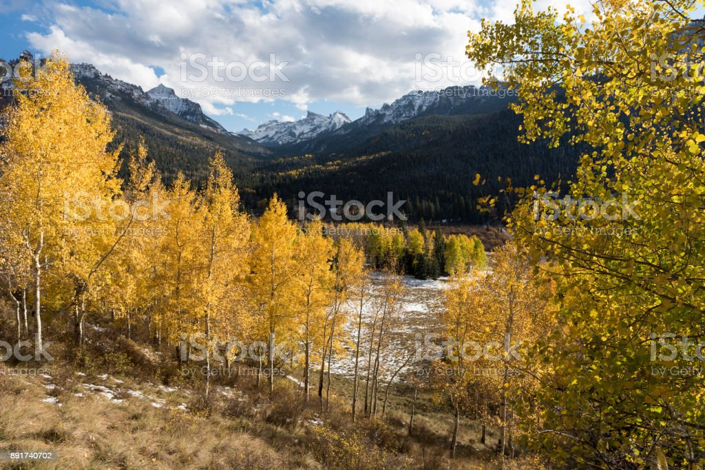 Redcliff Peak and Coxcomb Peak viewed from Cimarron River Valley after early fall snow storm stock photo