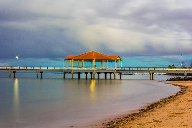 Redcliffe pier cloudy sunset stock photo