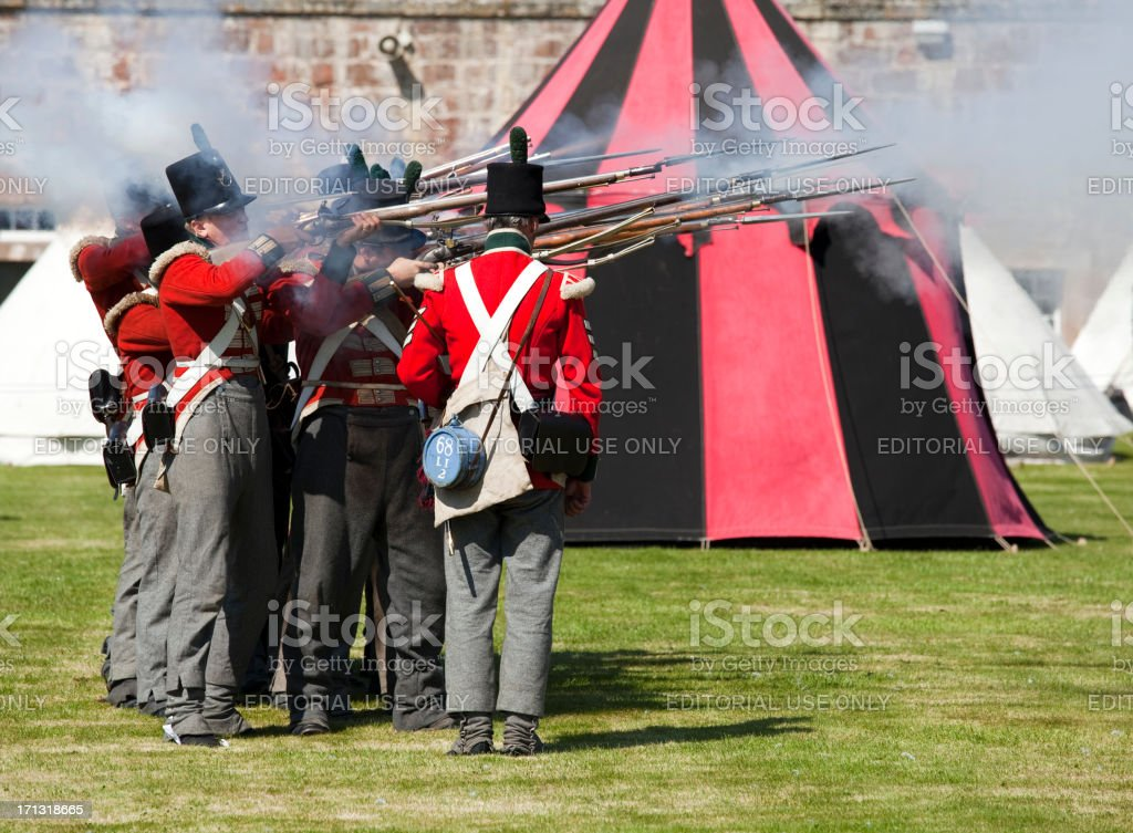 Redcoats firing a volley royalty-free stock photo