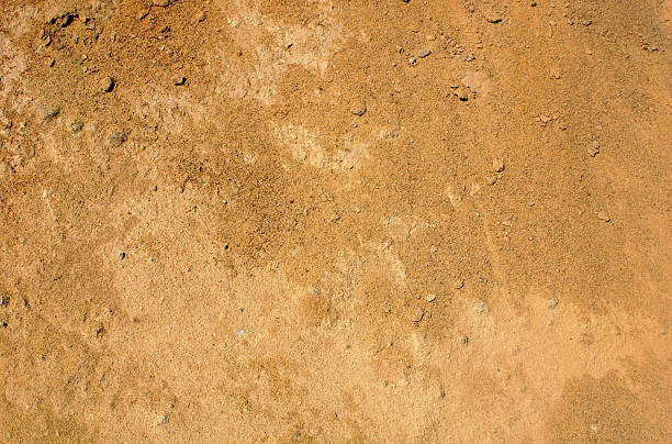 reddish brown dirt background - land stock photos and pictures