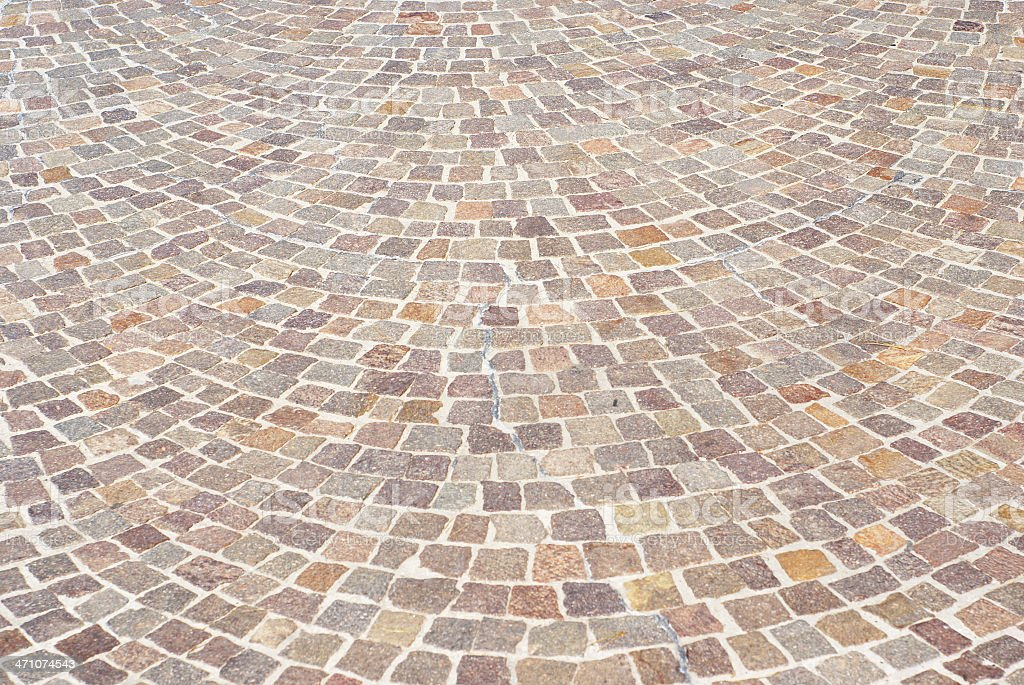 Reddish cobblestone pavement royalty-free stock photo