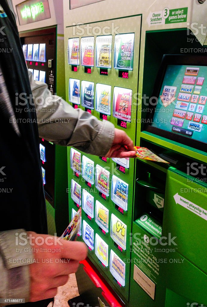 Redeeming a Winning Ticket at Lottery Vending Machine stock photo