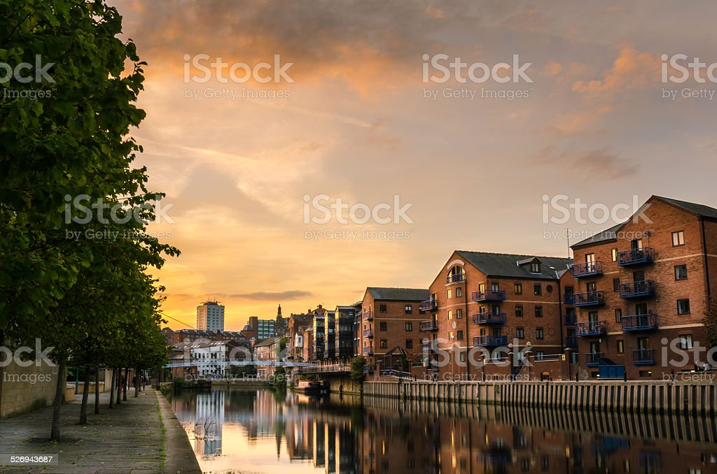 Redeveloped Warehouses along a River at Sunset stock photo