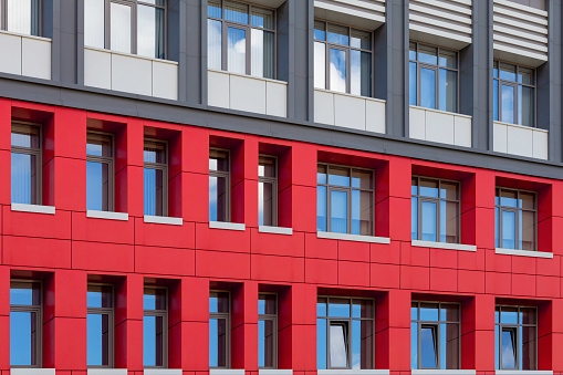 istock Red-gray modern ventilated facade with windows. Fragment of a new elite residential building or office center. 1248329486