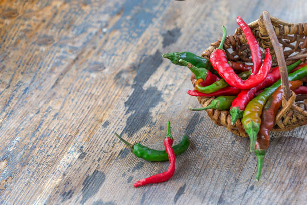 red,green chili in wicker basket stock photo