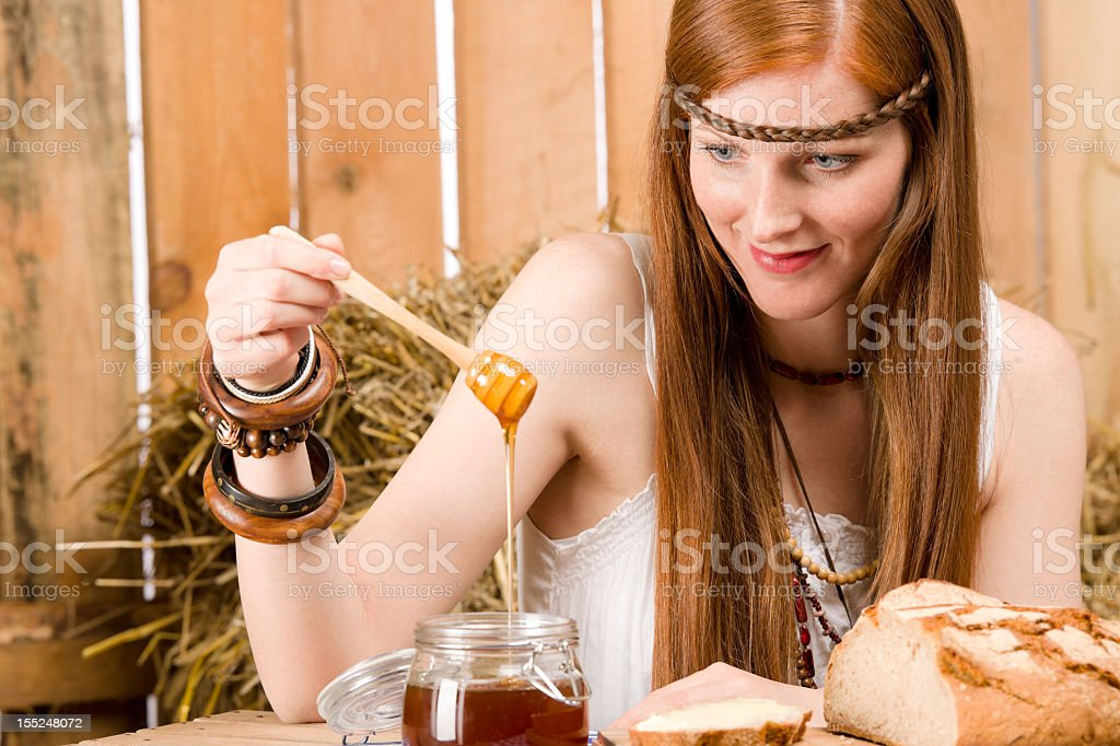 Red-hair young hippie woman breakfast in barn stock photo