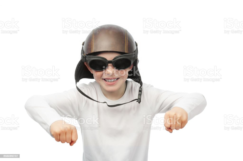 red-haired boy with freckles, motorcycle glasses and helmet royalty-free stock photo