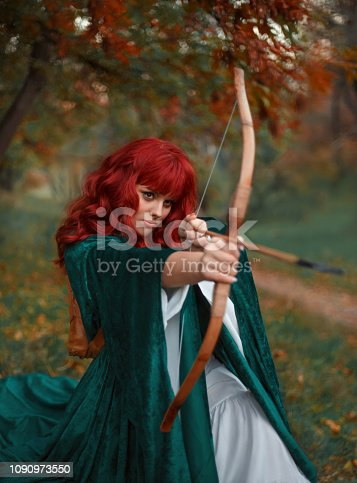 red-haired fiery robber in moment before attack, the legend of Robin Hood, girl is holding a bow and arrow in her hands, awaiting in amazing cloak and white silk expensive dress, warm colors, Gothic.