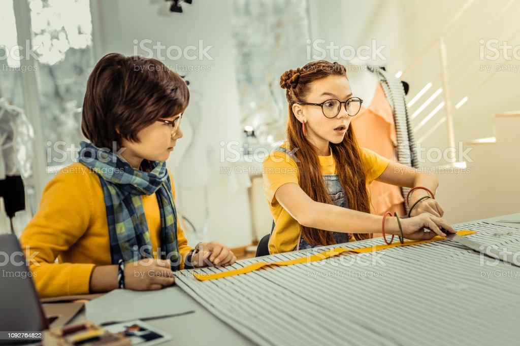 Redhaired Girl Having Many Creative Ideas While Designing Clothes Stock Photo Download Image Now Istock