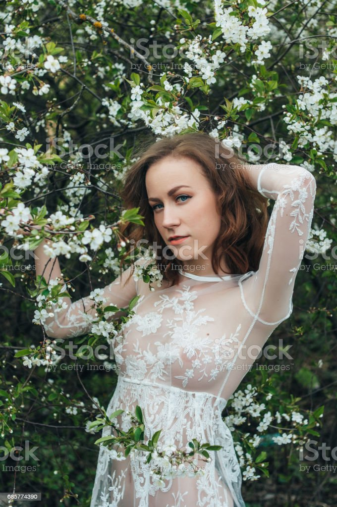 Red-haired girl in cherry royalty-free stock photo