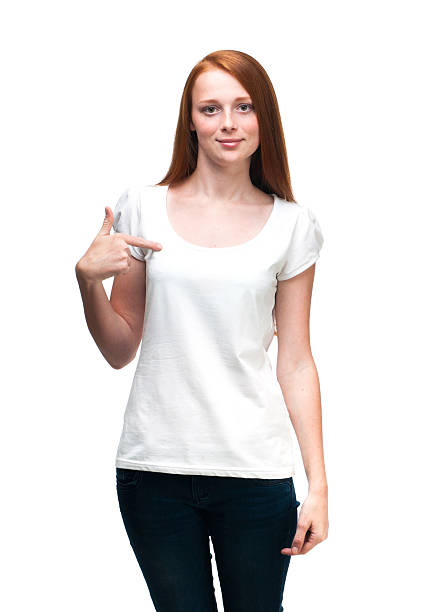 Red-haired girl showing on t-shirt. Red-haired girl showing on t-shirt.  Isolated on white background dark spots face stock pictures, royalty-free photos & images