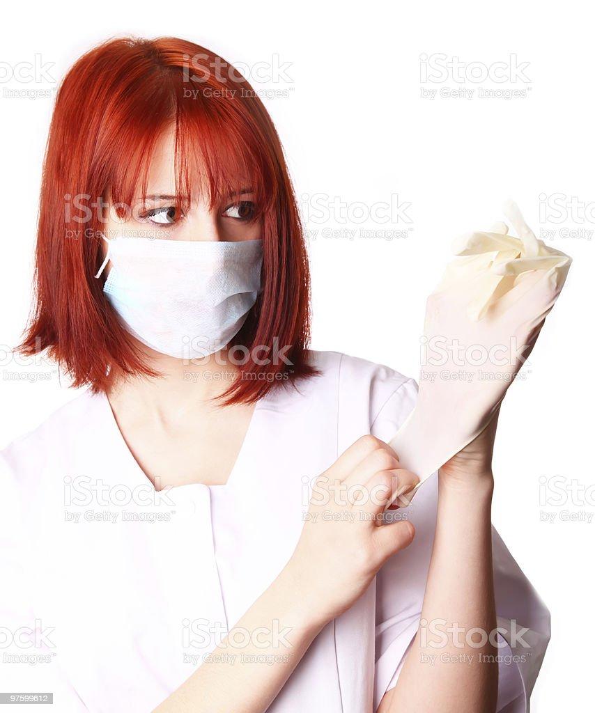 Red-haired girl with glove royaltyfri bildbanksbilder