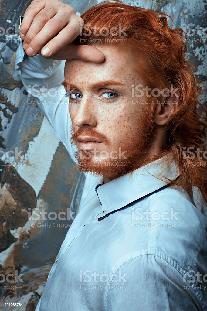 Red-haired man in white shirt metrosexual. stock photo