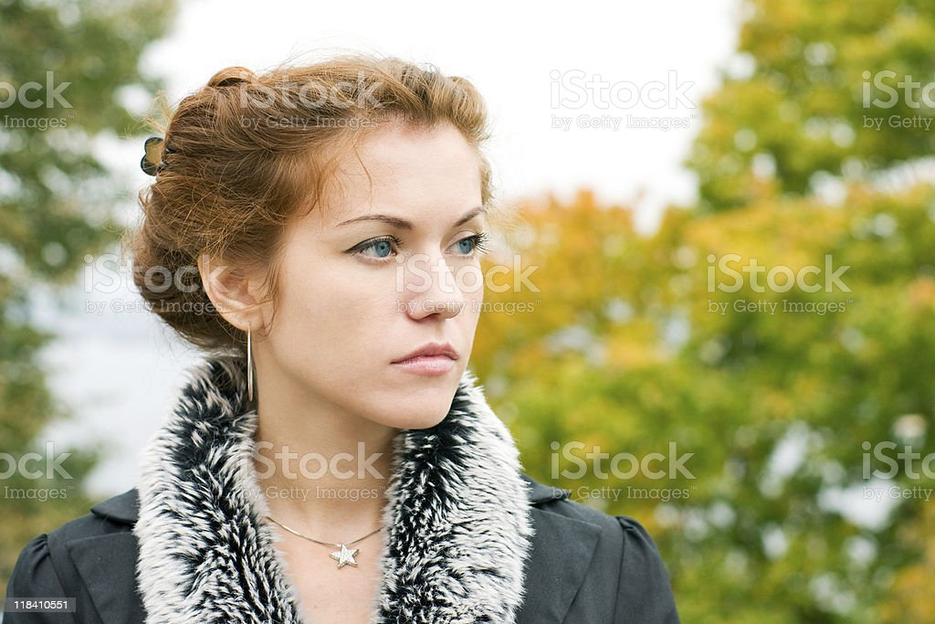 Red-haired pensive woman royalty-free stock photo