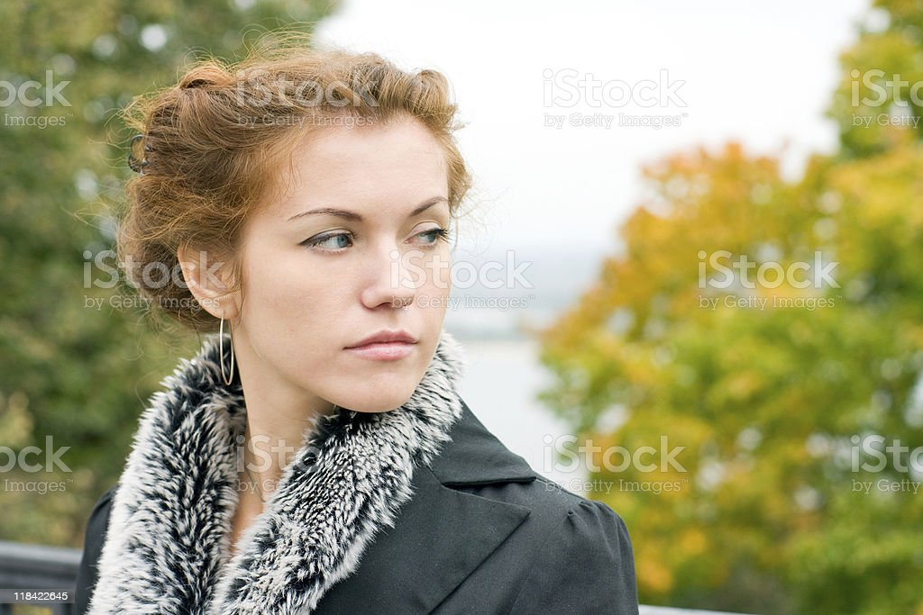 Red-haired pensive woman stock photo