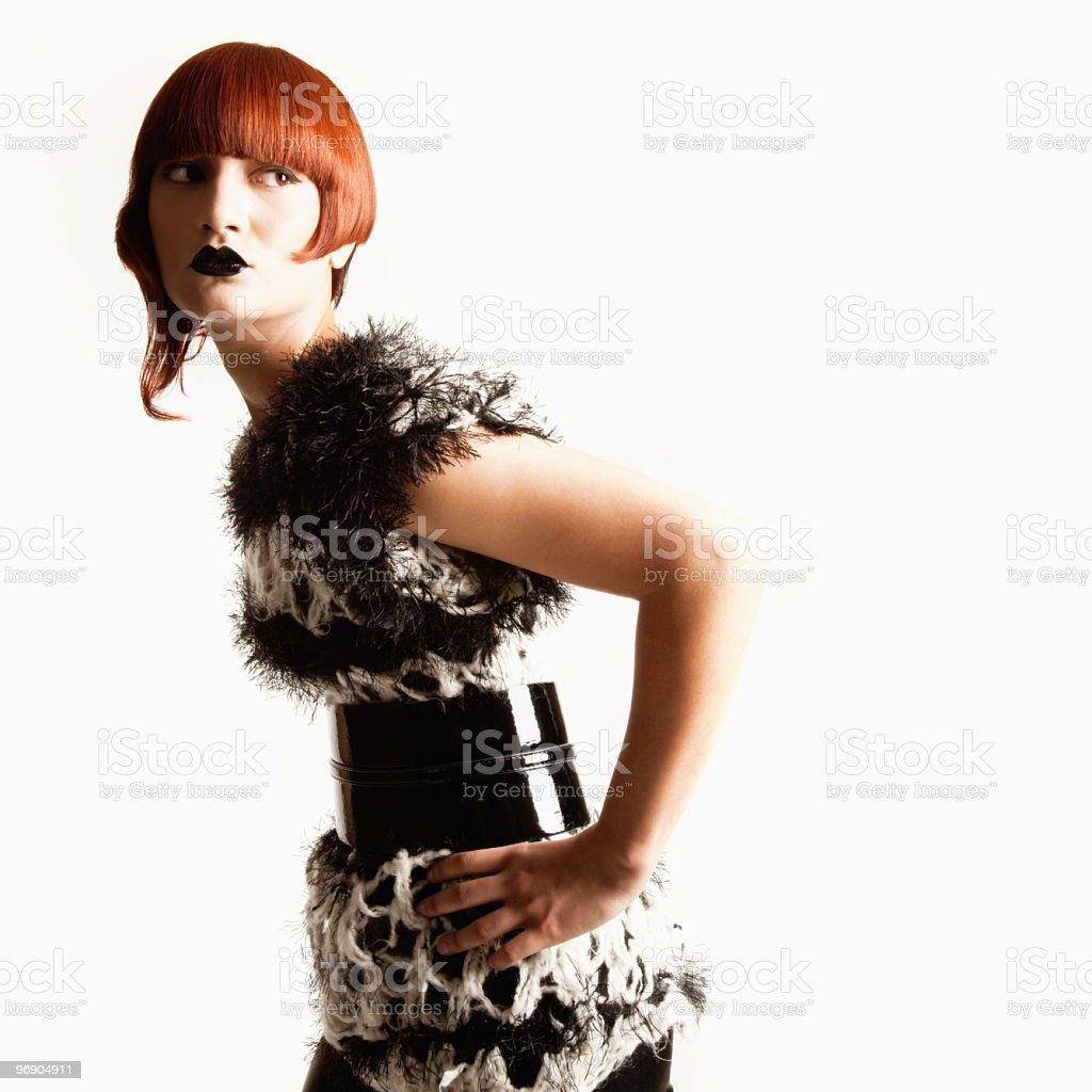 Red-Haired Woman in Avant-Garde Attire royalty-free stock photo