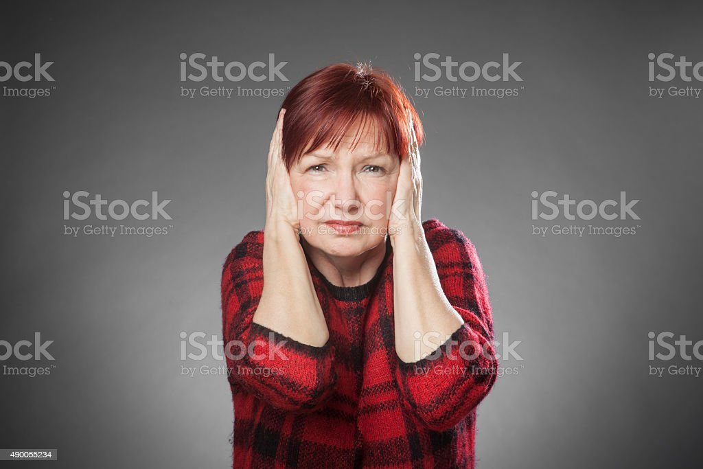 Red-haired woman, Portrait, hearing, too loud stock photo