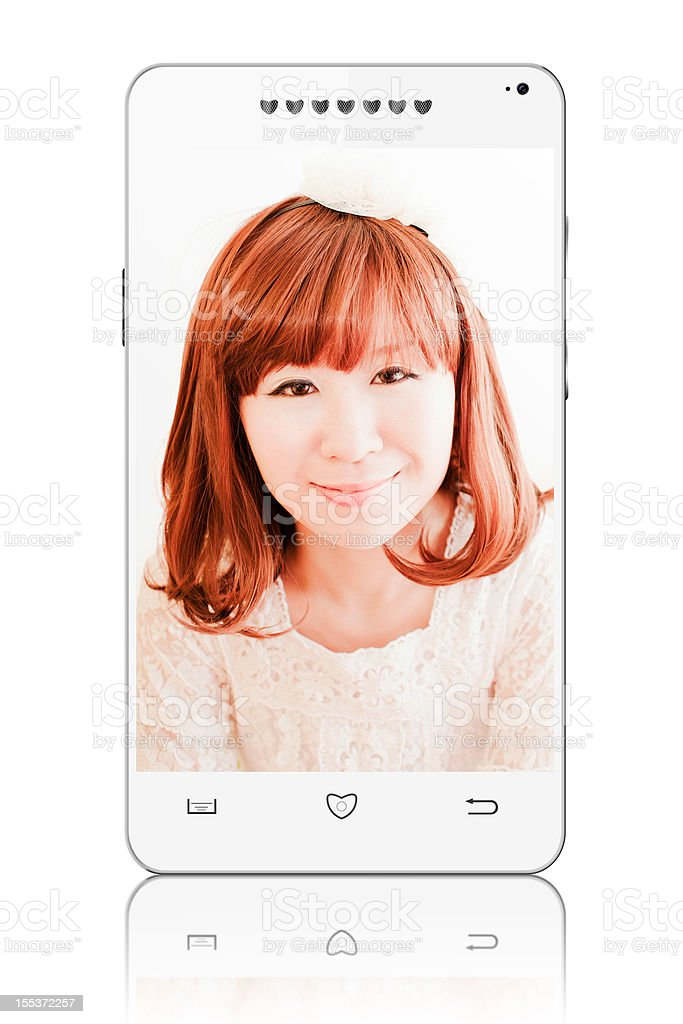 Red-Haired Woman Video Calling on Smart Phone royalty-free stock photo