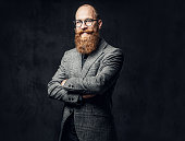 istock Redhead bearded male in a suit. 1074569252