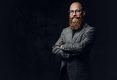 istock Redhead bearded male in a suit. 1074573588