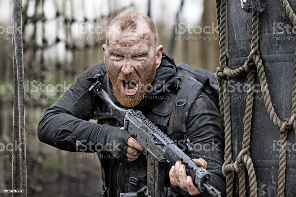 Redhead Bearded Middle Aged Soldier in Military Shoot in woodlands stock photo