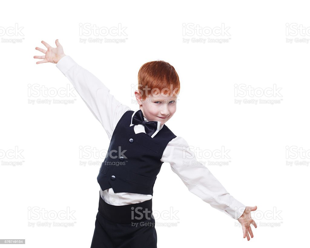 Redhead boy in a vest with bow tie, portrait isolated stock photo