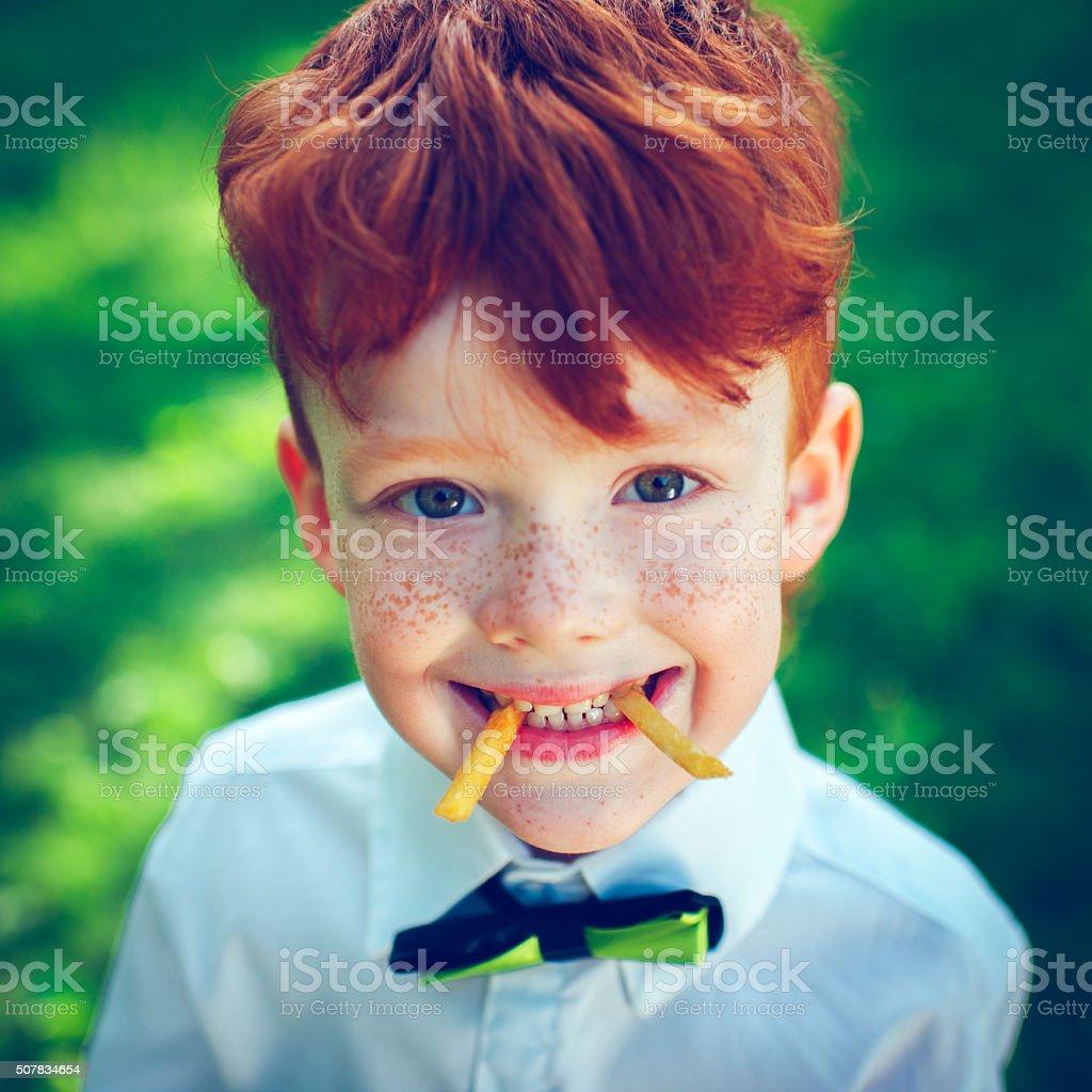 Redhead boy outdoors stock photo