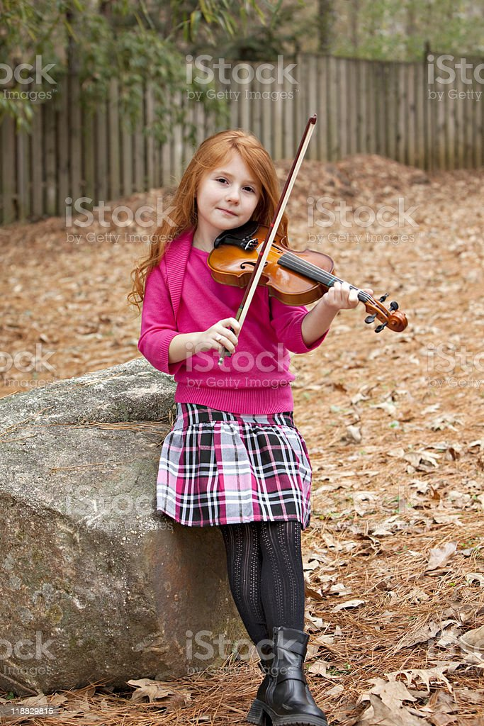 Redhead child with violin royalty-free stock photo