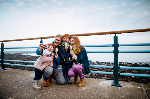 Redhead Family Taking a Selfie at the Coast