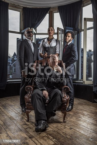 Redhead Gangster Mafia Man with his crew of criminals sat in his throne in a townhouse